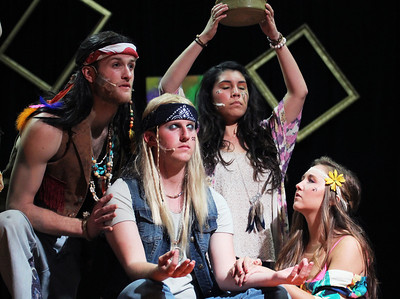 Richard Walden, Cressler Peele, Amberly Nardo, and Rachael Tuton, meditate in the opening number of Pauper Players' production of Hair