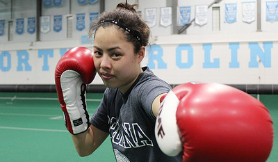 UNC Boxer and National Champion, Michelle Kern, posing after practice