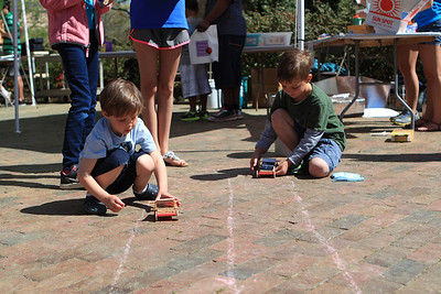The North Carolina Science Festival took place at UNC on Saturday. The North Carolina Science Festival is an initiative of Morehead Planetarium and Science Center. Sam and Quinn Huckabee (ages 4 and 7) from Durham race solar powered cars. They came with their Dad.
