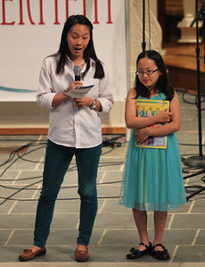 "Musical Empowerment teacher Sarah Chen, left, introduces her student Minseo. Minseo, 10, performed ""Cruella de Vil"" on the piano."