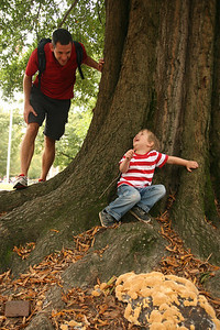 "Ben Lyles, two, plays a game of hide and seek on the upper quad Thursday afternoon with his father Ward, a doctoral student who lives in Durham. ""We're just spending an afternoon playing,"" said Ward."