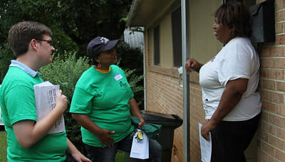 Linda Smith meets Delores Bailey, executive director of Empowerment Incorporated, and Lee Storrow, Chapel Hill Town Council member, as part of the Northside walk to encourage getting to know neighbors.