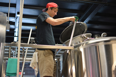 Connor Van Dyke, a senior at UNC, explains the brewing process at Steel Spring Brewery in Carrboro.