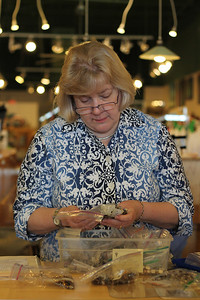 Carolyn George, Womancraft gifts member, organizes her jewelry Garden Stones.  She began designing jewelry as a hobby.  Womancraft Gifts is a co-op of 36 local artists.