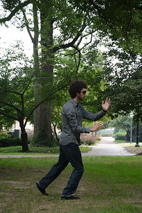 Joseph De Leo, a post-doc psychology student, practices Tai Chi in McCorkle Place in the late afternoon. De Leo is interested in the benefits of the art, as it applies to his studies and his own health.