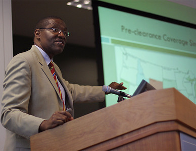 Kareem Crayton, Associate Professor of Law, introduces the Voting Rights, Racial Justice and Moral Mondays: Examining Civil Rights in the 21st Century symposium in Wilson Library on Thursday.