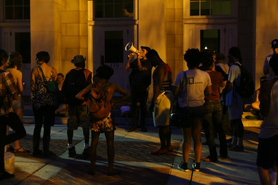Protestors gather at the Peace and Justice Plaza on Friday to show support of everyone who is resisting in Ferguson, Missouri.