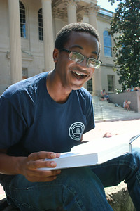 "Raymond Blackwell, a Junior Chemistry major is ready to get back into the Carolina lifestyle (pictured Monday afternoon reading on the main quad). In a moment of advice for the new first years, Blackwell commented, ""Take advantage of all of the opportunities at Carolina while you can. Go out and look for stuff to do, be proactive. There's so much going on at Carolina if you just make an effort to look for stuff then you're never going to be bored. If you're bored then you're doing college wrong."""