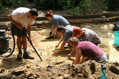 While doing construction work at UNC President Tom Ross's house on Franklin Street the remains of the original house were discovered under the driveway. Professors and graduate students from UNC's Research Laboratories of Archaeology work to unearth ruins from the site.