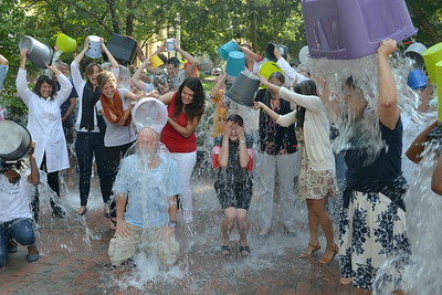 Individuals come together Wednesday afternoon outside of Davie Hall to complete the ALS ice bucket challenge in honor of a psychology professor who was recently diagnosed with ALS.