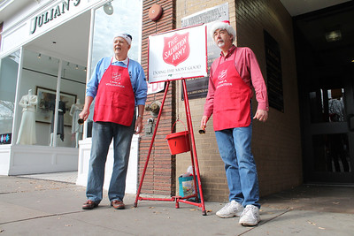 Salvation Army canvases on Franklin Street.  LEFT TO RIGHT John Sehon, Retired Philip Hughes, Chemist at Duke