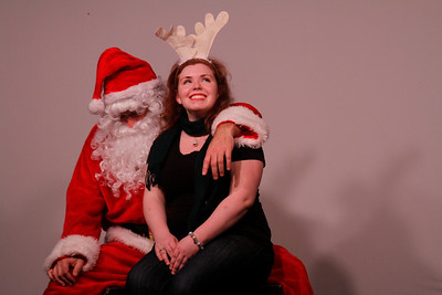 "Kate Harlow tells Santa, Brad Taylor, what she wants for Christmas. DSI Comedy hosted ""Love in the Time of Santa Claus"" in Carrboro. This performance will happen every Saturday in December."