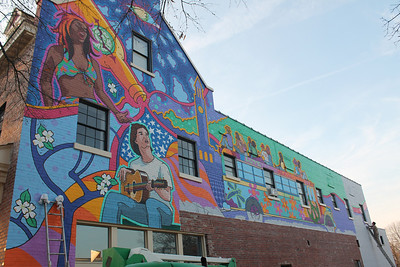 Mural Artist, Michael Brown, continues his work on his Mural for Mellow Mushroom at 310 W. Franklin Street.