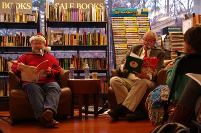 "UNC Student Stores employee George Morgan (left) and Professor Tom Stumpf (right) read ""How the Grinch Stole Christmas"" in Latin and English at Bull's Head Bookshop's annual reading."