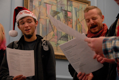 First-year Neal Siekierski carols with Mike Dimpfl, a graduate student active in Student Action for Workers, at noon on Monday in the South Building to protest business practices utilizing sweatshop labor overseas through a series of worker's rights themed holiday songs.