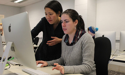 "Professor Hong-an Truong talks to Audrey Anderson, a sophomore drama and communications major, as she works on her final project in Art 106, ""Core Concepts: Time."" The project is a way to show time-based works of art through digital media."