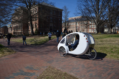 Nathan Jeffay, VP of Epsilon Eta Environmental Honors Fraternity demonstrates the ELF velomobile on campus. The ELF velomobile is a solar and pedal powered vehicle designed to fill the niche between a bike and a car. The project of Organic Transit in Durham, NC, was successfully funded by Kickstarter backers on January 13th. Street legal in all 50 states, the ELF can reach speeds of 20 mph with the solar powered motor, and even faster speeds when used in conjunction with the pedals.