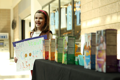 "Homeschool Girl Scout Troop 1152 sells the newly-named cookies at University Mall. Their most memorable sale occurred when a gentleman asked about the largest tip they had received, which was $20. He proceeded to buy two boxes, pay with a one hundred dollar bill, and said, ""Now this is your biggest tip."" The girls said that sales have been about the same or maybe better than they were last year. Olivia Kerns, 8 of Durham, holds a sign saying, ""Girl Scout Cookies $3.50"" as advertisement for the cookies she is helping her troop sell."