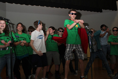 Dance Marathon hosted a Mini Dance Marathon at McDougal Middle School in Carrboro on Friday night. Austin Mejia, 14, (sunglasses and cape) leads dancers to the song Gangnam Style by Psi.