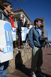 Students campaigning for  Will Lindsey and Christy Lambden in the pit . Andrew Wood holds a sign for Lindsey campaign.