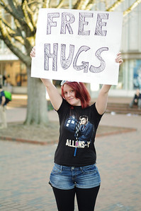 "Liz Hobbs, from Clayton, NC, ​was visiting her friend and decided to give out free hugs by the pit. She used to give out free hugs at ECU when she was a student there. She says she does it because everyone loves hugs. ""Some people laughed at me, but that's okay,"" she says, ""the point is to make people smile nonetheless."""