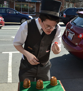 """Nate the Magician"" from Chapel Hill performs magic on Franklin Street during the afternoon on February 23rd. Nate has been performing magic his entire life and did a project on Harry Houdini when he was in First Grade."