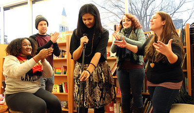 UNC Wordsmiths Mariah Monsanto, Wil Broadwell, Lauren Bullock, Polina Bastrakova, and Julia McKeown, pictured on Thursday in Bulls Head Bookshop, are getting ready for a Grand Slam on Saturday night. Bullock approaches the mic as her teammates support her.
