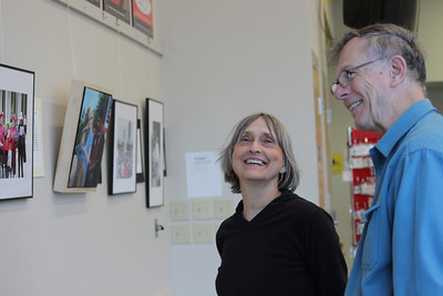 "Suzanne Lamport and one of the artists Dave Otto enjoy browsing the exhibition.  The activist exhibition of artist David Taylor, Harry Phillips, and photographer Dave Otto is called ""Images of Moral Mondays"", which displays artwork of the ongoing speeches and protests of major issues, including unemployment, voting rights, health care, education, and many more."