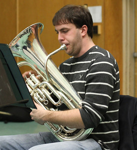 "Grant Credle, a junior Music and Business double major, rehearses with the Quartodd Tuba Quartet.  The quartet will play ""Power"" by John Stevens and ""Contrapunctus IV"" by J.S. Bach at a concert on February 8 at 8:00pm in Kenan Rehearsal Hall.  ""This is an up and coming ensemble, but a tuba quartet has always existed at UNC and there's a will, so there's a way,"" said Harrison."