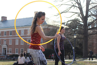 Michelle Swanson, a senior East Asian Studies major, hula hoops in the quad with the Carolina Hula Hoop Club on Monday afternoon.