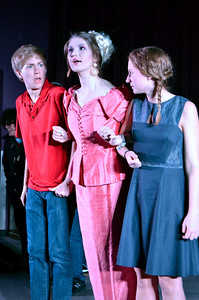 Drew Goins, as Peeta, Emily Ruffin as Katniss, and Annie Keller, as Effy, perform on Thursday evening in the upcoming production of the Hunger Games by Pauper's Broadway Melodies.