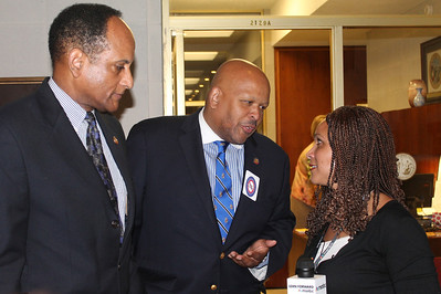 Melissa Harris-Perry of MSNBC (left) speaks with members of the N.C. Legislative Black Caucus.