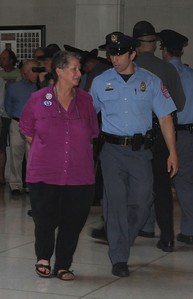 At the protest's end, more than 150 people were led from the legislative building in handcuffs.