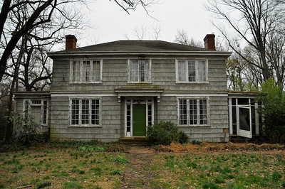 An abandoned historic house, located on 704 Gimghoul Road in Chapel Hill. A local couple is requesting to tear the house down and build a new one in its place. This cloudy day gives the house an antique feel.
