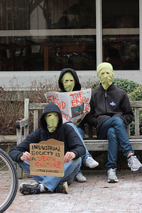 "Three members of the Luddite group on campus, who wish to remain anonymous, demonstrate outside of the Undergraduate Library on Thursday to advocate a way of life that rejects industrialism and technology. ""We performed the action in the pit to bring attention to the fact that the Luddites exist. Also, we kinda just did the action to have fun,"" said their spokesperson John Eivy."