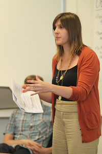 UNC Student Wellness Instructor, Annie Peacock, Carrboro. Background: Albert Thrower, Chapel Hill.