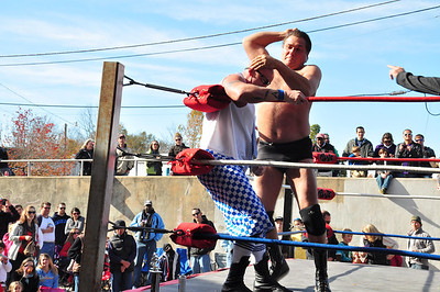 Over the weekend the Raleigh Saturday Farmer's Market presented a Gouge Wrestling and Food Truck Rodeo event where food trucks from all over the Triangle came together as people gathered to watch the locally famous gouge wrestlers. Mr. Handsome finishes off Seymour Snott to win this round.