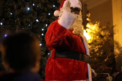 Santa poses for a picture at the Tree Lighting Ceremony in downtown Chapel Hill.