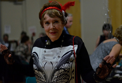 Linda Mews poses at The Gatsby Gala at the Seymore Center on Saturday evening.