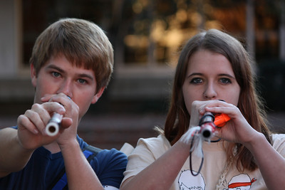 Sophomore  Tanner Fadero and graduate Laura Stubbs demonstrate the use of their blow guns that they will use during Humans vs. Zombies.