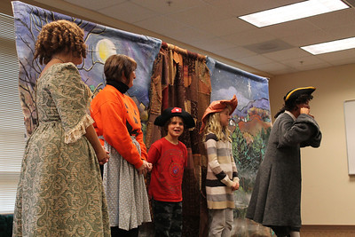 "On Tuesday, October 30th, the Bright Star Theater company, from Asheville, NC, performed their rendition of the ""Legend of Sleepy Hollow"" at the Orange County Public Library in Hillsborough for an audience of young children and their parents. During the performance, the actors invited two children, Eli Aquino, 8 years old and a student at Cameron Park Elementary, and Hattie Bendall, 9 years old and a student at McDougle Elementary, to join them singing on stage."