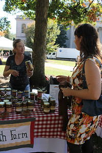 Staff member Shana Garr buys preserves from Rose Shepherd of Blessed Earth Farm at the Farmers Market in Polk Place run by Carolina Dining Services. Rose has been making preserves for thirty years, and has been selling them from her home for ten.