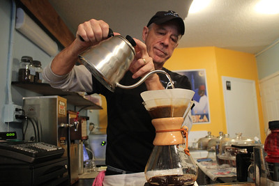 "Jay Reeves owner and manager of Vinyl Perk, which opened October 18h, makes coffee through a process called pouring over. ""This way of making coffee has been around for about 60 years and uses no machines. Making coffee this way takes away the bitterness and you can really taste the coffee bean when drinking it."""