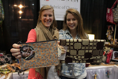 "A Ban Against Neglect had a booth at the Raleigh Convention Center Shopping Spree event held by the Junior League of Raleigh on Saturday. ABAN started out as a class project during co-founder Callie Brauel's study abroad trip in Ghana in 2008. She and the other co-founders were discouraged by the amount of trash they found in the area so they started a recycling program, especially for the plastic water packets the villagers used. Their accessory line started with coin purses made out of those plastic bags and has grown into a much larger venture now, with teams of seamstresses working on their new line of bags and jewelry (made out of recycled glass).  They started employing seamstresses when they realized that doing the production themselves was taking away from the time the teen moms they were helping had for their studies. The main goal is to use the profits from these accessories to help pay for education for the women enrolled in their program.  Callie and another study abroad student were working with teen moms during the initial recycling programs.   ""Seeing the situations these girls were going through, that they didn't really have any hope or future, in girls who were our age or younger, it just didn't seem fair.""   ""Just even seeing that we've helped one woman is really remarkable."""