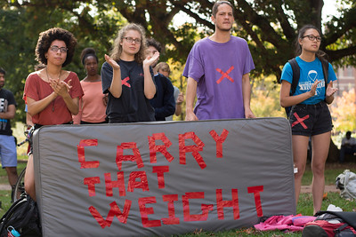 "Student protesters from the ""Carrying the Weight Together,"" a national effort to bring awareness to sexual assault injustice at colleges,  applaud speeches given at the Wainstein Rally."