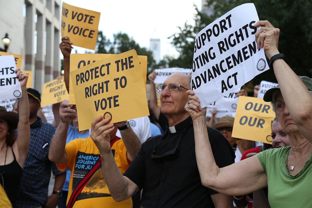 """The NAACP lead a march and rally in Raleigh on Thursday as part of """"America's Journey for Justice,"""" a 806-mile march from Selma, Alabama, to Washington D.C. Hundreds gathered in the Bicentennial Plaza to protest for voters' rights."""