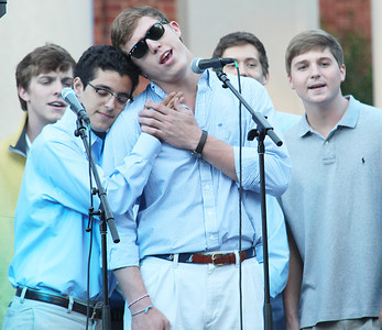 Three campus a cappella groups sang to an audience in front of moorehead planetarium.   Clef Hangers.