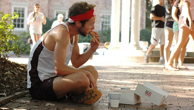 The second annual Donut Dash. Runners competed with a 4 mile race and eating 12 donuts.  Sophmore Connor Belson, Public Health major, enjoys a break. Connor would go on to take first place.