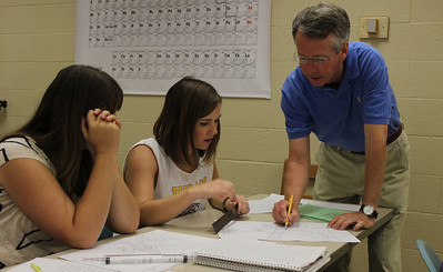 "Professor Dr. Kevin Stewart who has been teaching Geology for 26 years talks to students during his 401 Structural Geology Lab. ""The students are working on how to interpret the architecture of deformed rock,"" said Stewart. ""I really enjoy teaching this class because the students are great. Geology has definitely become more popular over the years as students become more aware with earth issues. When I first started teaching this class, there were only 3 students in the lab; now the class is full."""