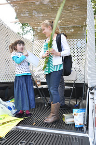Chaya Bluming (left) and Adi Blanc (right) recite a Jewish blessing in the traveling sukkah.